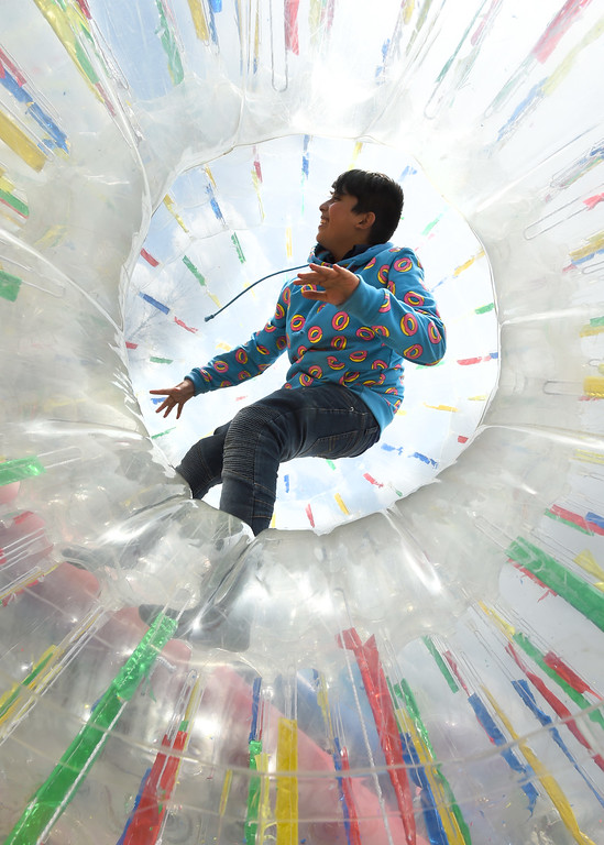 . Danny Orozco took one of the Zorbs for a ride. Longmont held its annual Cinco de Mayo celebration at Roosevelt Park on Saturday. For more photos and a video, go to dailycamera.com. Cliff Grassmick  Photographer  May 5,  2018