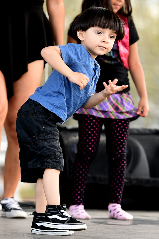 . Zol Trujillo, 3, shows off his dance moves on Saturday. Longmont held its annual Cinco de Mayo celebration at Roosevelt Park on Saturday. For more photos and a video, go to dailycamera.com. Cliff Grassmick  Photographer  May 5,  2018