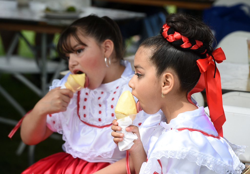 . Melanie Valasquez, left, and Brittany De Luna, enjoy ice cream at the Festival. Longmont held its  annual Cinco de Mayo celebration at Roosevelt Park on Saturday. For more photos and a video, go to dailycamera.com. Cliff Grassmick  Photographer  May 5,  2018
