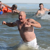 Dale Haas, of Louisville, runs out of the frigid water during the 30th annual New Year's Day Polar Plunge at the Boulder Reservoir Tuesday Jan. 01, 2013. (Lewis Geyer/Times-Call)