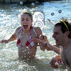 Isa Wisnann-Horther reacts to the cold water during the 30th annual New Year's Day Polar Plunge at the Boulder Reservoir Tuesday Jan. 01, 2013. (Lewis Geyer/Times-Call)