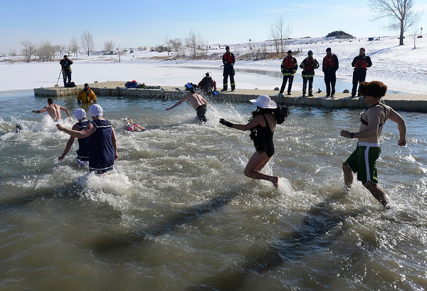 Participants run into the water during the 30th annual New Year's Day Polar Plunge at the Boulder Reservoir Tuesday Jan. 01, 2013. (Lewis Geyer/Times-Call)