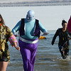 Dressed as a blue genie, Booboo Wilde checks his outfit after running into the water during the 30th annual New Year's Day Polar Plunge at the Boulder Reservoir Tuesday Jan. 01, 2013. (Lewis Geyer/Times-Call)
