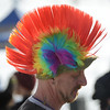 Brent Burnham, of Denver, has chosen a colorful hat to wear at the 30th annual New Year's Day Polar Plunge at the Boulder Reservoir Tuesday Jan. 01, 2013. (Lewis Geyer/Times-Call)