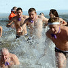 Members and friends of CU's rugby team run out of the water during the 30th annual New Year's Day Polar Plunge at the Boulder Reservoir Tuesday Jan. 01, 2013. (Lewis Geyer/Times-Call)