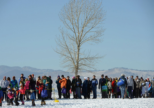 Participants wait in line at the 30th annual New Year's Day Polar Plunge at the Boulder Reservoir Tuesday Jan. 01, 2013. (Lewis Geyer/Times-Call)