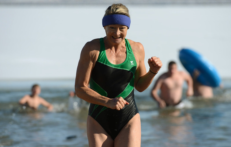 Jenny Miles, of Longmont, heads to the warming tent during the 30th annual New Year's Day Polar Plunge at the Boulder Reservoir Tuesday Jan. 01, 2013. (Lewis Geyer/Times-Call)