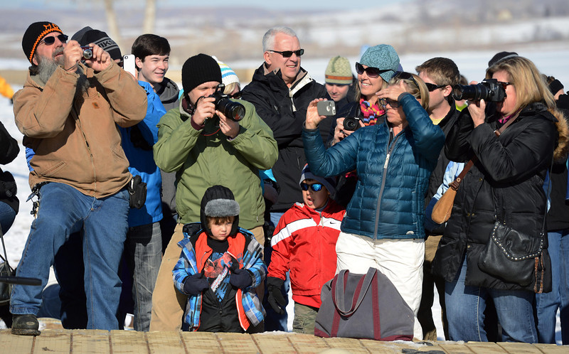 Spectators line the dock to watch the 30th annual New Year's Day Polar Plunge at the Boulder Reservoir Tuesday Jan. 01, 2013. (Lewis Geyer/Times-Call)