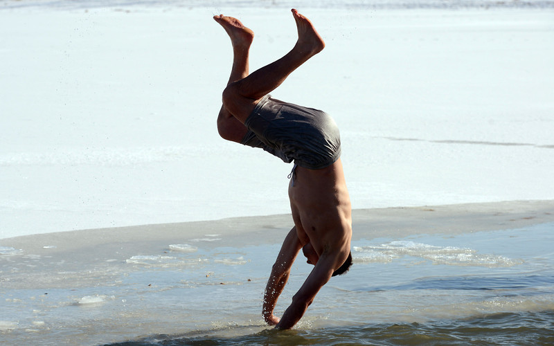 Sean Donnelly, of Boulder, does a cartwheel back into the water during the 30th annual New Year's Day Polar Plunge at the Boulder Reservoir Tuesday Jan. 01, 2013. (Lewis Geyer/Times-Call)