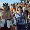 Paul Muus, left, of Louisville, waits to go into the water during the 30th annual New Year's Day Polar Plunge at the Boulder Reservoir Tuesday Jan. 01, 2013. (Lewis Geyer/Times-Call)