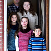 Dave Gaccetta and Becky Gaccetta pose for a portrait with their children, Wednesday, Dec. 19, 2012, next to a door that belonged to Dave Gaccetta's his great grandparents' home built in 1912 in Denver. The door now resides at their home in Longmont.<br /> (Matthew Jonas/Times-Call)