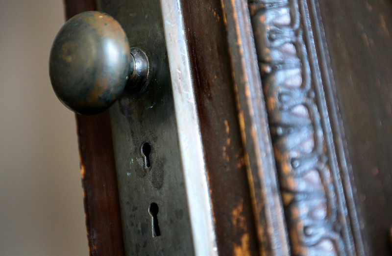 The original door handle with dual locks is seen, Wednesday, Dec. 19, 2012, at the Gaccetta's home in Longmont.<br /> (Matthew Jonas/Times-Call)