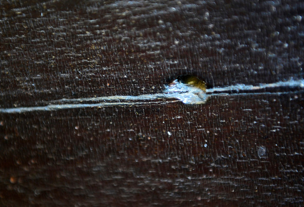 A bullet hole along with the bullet are seen, Dec. 19, 2012, lodged in the door that was part of Dave Gaccetta's great grandparents' home in Denver and is now located at their home in Longmont.<br /> (Matthew Jonas/Times-Call)