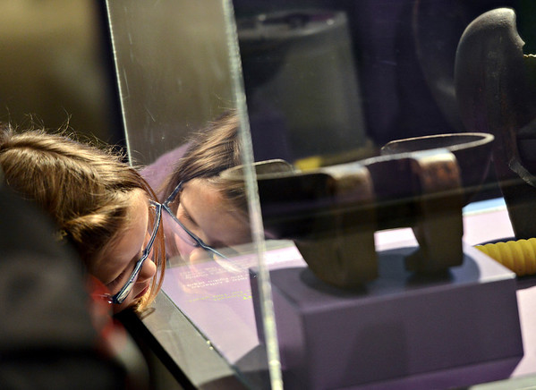 20121119_AMPD_298.jpg Madelyn Baum, 7, examines a display while exploring the AMP'D exhibit at the Longmont Museum & Cultural Center with her mother Krystin on Monday, Nov. 19, 2012.  The exhibit, which is open through February 17, features many hands-on activities and information about the centennial of Longmont Power & Communications.<br /> (Greg Lindstrom/Times-Call)