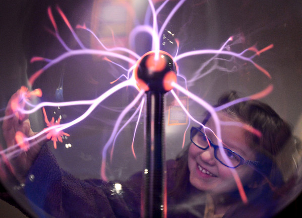 """20121119_AMPD_144.jpg Madelyn Baum, 7, plays with a plasma globe while exploring the AMP'D exhibit at the Longmont Museum & Cultural Center with her mother Krystin on Monday, Nov. 19, 2012.  The exhibit, which is open through February 17, features many hands-on activities and information about the centennial of Longmont Power & Communications.  For more photos and a video visit  <a href=""""http://www.TimesCall.com"""">http://www.TimesCall.com</a>.<br /> (Greg Lindstrom/Times-Call)"""
