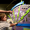 "20121119_AMPD_061.jpg Andrew Telgenhof, 9, points as his brother Adam, 5, powers a hand crank while exploring the AMP'D exhibit at the Longmont Museum & Cultural Center on Monday, Nov. 19, 2012.  The exhibit, which is open through February 17, features many hands-on activities and information about the centennial of Longmont Power & Communications.  For more photos and a video visit  <a href=""http://www.TimesCall.com"">http://www.TimesCall.com</a>.<br /> (Greg Lindstrom/Times-Call)"