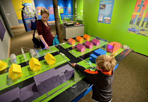 """20121119_AMPD_036.jpg Marik Magginetti, 5, and his mother Meghan play with a model while exploring the AMP'D exhibit at the Longmont Museum & Cultural Center on Monday, Nov. 19, 2012.  The exhibit, which is open through February 17, features many hands-on activities and information about the centennial of Longmont Power & Communications.  For more photos and a video visit  <a href=""""http://www.TimesCall.com"""">http://www.TimesCall.com</a>.<br /> (Greg Lindstrom/Times-Call)"""