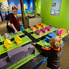 "20121119_AMPD_036.jpg Marik Magginetti, 5, and his mother Meghan play with a model while exploring the AMP'D exhibit at the Longmont Museum & Cultural Center on Monday, Nov. 19, 2012.  The exhibit, which is open through February 17, features many hands-on activities and information about the centennial of Longmont Power & Communications.  For more photos and a video visit  <a href=""http://www.TimesCall.com"">http://www.TimesCall.com</a>.<br /> (Greg Lindstrom/Times-Call)"