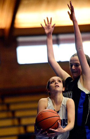 "Longmont Christian's Ashley Jauregui looks to shot over Alexander Dawson's Lindsey Gallop during the game at the St. Vrain Memorial Building in Longmont on Monday, Feb. 11, 2013. For more photos visit  <a href=""http://www.BoCoPreps.com"">http://www.BoCoPreps.com</a>.<br /> (Greg Lindstrom/Times-Call)"