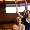"""Longmont Christian's Ashley Jauregui looks to shot over Alexander Dawson's Lindsey Gallop during the game at the St. Vrain Memorial Building in Longmont on Monday, Feb. 11, 2013. For more photos visit  <a href=""""http://www.BoCoPreps.com"""">http://www.BoCoPreps.com</a>.<br /> (Greg Lindstrom/Times-Call)"""