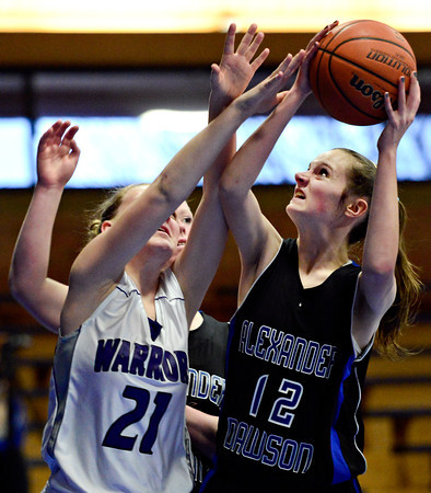 """Alexander Dawson's Lindsey Gallop (12) shoots over Longmont Christian's Emma Stair (21) during the game at the St. Vrain Memorial Building in Longmont on Monday, Feb. 11, 2013. For more photos visit  <a href=""""http://www.BoCoPreps.com"""">http://www.BoCoPreps.com</a>.<br /> (Greg Lindstrom/Times-Call)"""