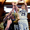 "Longmont Christian's Allison Cochran (25) goes up for a shot over Alexander Dawson defenders during the game at the St. Vrain Memorial Building in Longmont on Monday, Feb. 11, 2013. For more photos visit  <a href=""http://www.BoCoPreps.com"">http://www.BoCoPreps.com</a>.<br /> (Greg Lindstrom/Times-Call)"