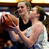 """Alexander Dawson's Lindsey Gallop, left, blocks a shot by Longmont Christian's Allison Cochran during the game at the St. Vrain Memorial Building in Longmont on Monday, Feb. 11, 2013. For more photos visit  <a href=""""http://www.BoCoPreps.com"""">http://www.BoCoPreps.com</a>.<br /> (Greg Lindstrom/Times-Call)"""