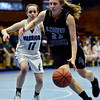 """Alexander Dawson's Fiona Bell (23) drives past Longmont Christian's Ashley Jauregui (11) during the game at the St. Vrain Memorial Building in Longmont on Monday, Feb. 11, 2013. For more photos visit  <a href=""""http://www.BoCoPreps.com"""">http://www.BoCoPreps.com</a>.<br /> (Greg Lindstrom/Times-Call)"""