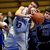 """Longmont Christian's Joe Leetch (23) competes for a rebound against Alexander Dawson's Zach Gallop (33) during the game at the St. Vrain Memorial Building in Longmont on Monday, Feb. 11, 2013. For more photos visit  <a href=""""http://www.BoCoPreps.com"""">http://www.BoCoPreps.com</a>.<br /> (Greg Lindstrom/Times-Call)"""