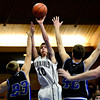 """Longmont Christian's Dylan Wehrli (10) shoots over Alexander Dawson's Noah Lorentzen (23) and Shawn O'Grady (42) during the game at the St. Vrain Memorial Building in Longmont on Monday, Feb. 11, 2013. For more photos visit  <a href=""""http://www.BoCoPreps.com"""">http://www.BoCoPreps.com</a>.<br /> (Greg Lindstrom/Times-Call)"""