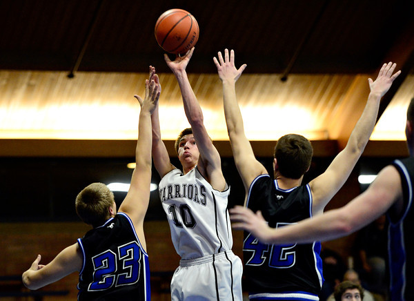 "Longmont Christian's Dylan Wehrli (10) shoots over Alexander Dawson's Noah Lorentzen (23) and Shawn O'Grady (42) during the game at the St. Vrain Memorial Building in Longmont on Monday, Feb. 11, 2013. For more photos visit  <a href=""http://www.BoCoPreps.com"">http://www.BoCoPreps.com</a>.<br /> (Greg Lindstrom/Times-Call)"