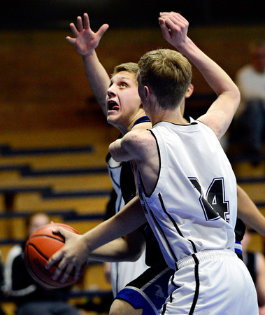 "Alexander Dawson's Noah Lorentzen looks to shoot over Longmont Christian's Cole Moffit (24) during the game at the St. Vrain Memorial Building in Longmont on Monday, Feb. 11, 2013. For more photos visit  <a href=""http://www.BoCoPreps.com"">http://www.BoCoPreps.com</a>.<br /> (Greg Lindstrom/Times-Call)"
