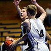 """Alexander Dawson's Noah Lorentzen looks to shoot over Longmont Christian's Cole Moffit (24) during the game at the St. Vrain Memorial Building in Longmont on Monday, Feb. 11, 2013. For more photos visit  <a href=""""http://www.BoCoPreps.com"""">http://www.BoCoPreps.com</a>.<br /> (Greg Lindstrom/Times-Call)"""