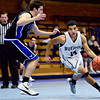 """Longmont Christian's Aaron Rodarte (14) drives past Alexander Dawson's Shawn O'Grady during the game at the St. Vrain Memorial Building in Longmont on Monday, Feb. 11, 2013. For more photos visit  <a href=""""http://www.BoCoPreps.com"""">http://www.BoCoPreps.com</a>.<br /> (Greg Lindstrom/Times-Call)"""