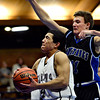 """Longmont Christian's Aaron Rodarte (14) goes up for a shot against Alexander Dawson's Cam Connor (11) during the game at the St. Vrain Memorial Building in Longmont on Monday, Feb. 11, 2013. For more photos visit  <a href=""""http://www.BoCoPreps.com"""">http://www.BoCoPreps.com</a>.<br /> (Greg Lindstrom/Times-Call)"""