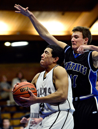"Longmont Christian's Aaron Rodarte (14) goes up for a shot against Alexander Dawson's Cam Connor (11) during the game at the St. Vrain Memorial Building in Longmont on Monday, Feb. 11, 2013. For more photos visit  <a href=""http://www.BoCoPreps.com"">http://www.BoCoPreps.com</a>.<br /> (Greg Lindstrom/Times-Call)"