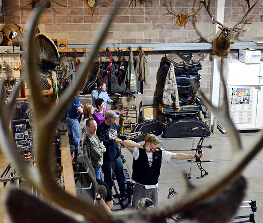 Archers take aim during a 3-D shoot at Archery in the Wild in Longmont on Wednesday, Jan. 30, 2013. <br /> (Greg Lindstrom/Times-Call)