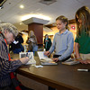 Avi signs a book for Rocky Mountain Christian Academy fourth grader Natalie VanTool Wednesday morning Feb. 27, 2013. Avi is the author of more than 70 books for children and young adults. (Lewis Geyer/Times-Call)