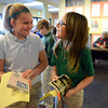 Rocky Mountain Christian Academy fourth graders Caitlin Rose, left, and Taylor Vandenburg compare signatures Wednesday morning Feb. 27, 2013 after having their books signed by Avi. Avi is the author of more than 70 books for children and young adults. (Lewis Geyer/Times-Call)