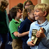 Rocky Mountain Christian Academy fourth grader Drew Jordan has his photo taken with his books written by Avi while waiting to have them signed Wednesday morning Feb. 27, 2013. Avi is the author of more than 70 books for children and young adults. (Lewis Geyer/Times-Call)