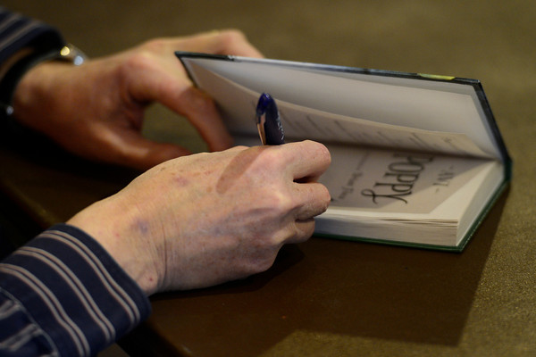 Avi signs a book after speaking to students at Rocky Mountain Christian Academy Wednesday morning Feb. 27, 2013. Avi is the author of more than 70 books for children and young adults. (Lewis Geyer/Times-Call)