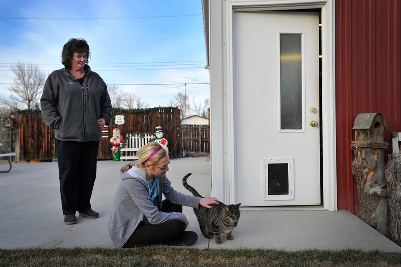 Debby Precht looks on as her daughter Maddie Precht pets Elmer, Tuesday, Jan. 8, 2013, at their home in Longmont.<br /> (Matthew Jonas/Times-Call)