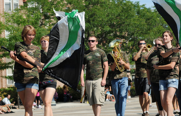 The Niwot Cougars marching band participates in the Boulder County Fair Parade in Longmont Saturday, July 31, 2010.  (Bradley Wakoff/Times-Call)