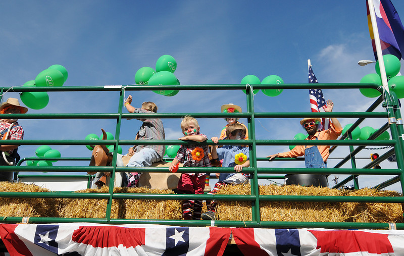 The Jax Mercantile float makes its way down Main Street during the Boulder County Fair Parade in Longmont, July 31, 2010.