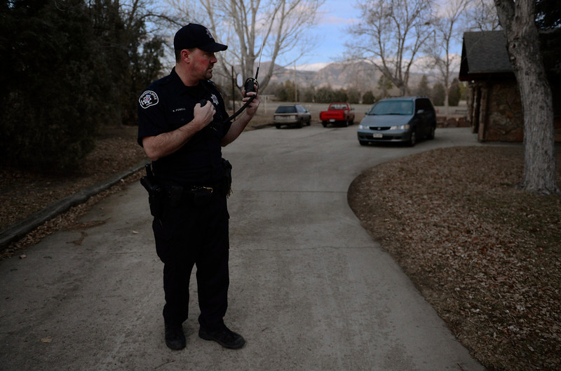 Boulder County Sheriff's deputy Keith Powell helps a fellow deputy (not pictured) attempt to serve an arrest warrant in a nearby home, Friday morning, Jan. 25, 2013 in a neighborhood east of Boulder. (Lewis Geyer/Times-Call)