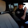 Boulder County Sheriff's deputy Keith Powell talks to dispatch while writing a ticket on Lookout Road, near North 79th Street, Friday morning, Jan. 25, 2013. (Lewis Geyer/Times-Call)