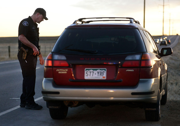 Boulder County Sheriff's deputy Keith Powell talks to a motorist he pulled over on Lookout Road, near North 79th Street, Friday morning, Jan. 25, 2013. (Lewis Geyer/Times-Call)