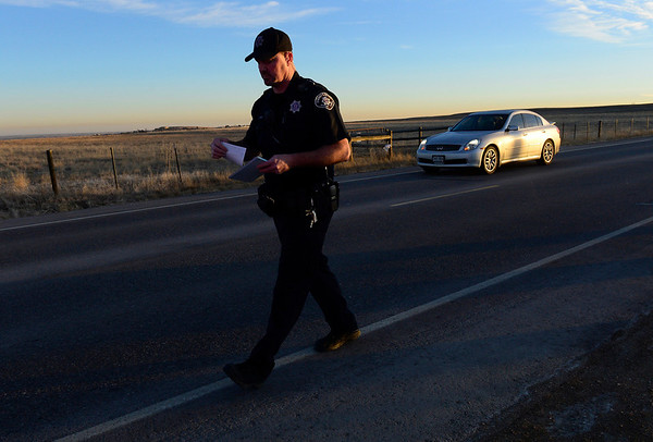 Boulder County Sheriff's deputy Keith Powell returns to his patrol vehicle while on a traffic stop on Lookout Road, near North 79th Street, Friday morning, Jan. 25, 2013. (Lewis Geyer/Times-Call)