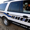 Boulder County Sheriff's deputy Keith Powell writes a ticket for a motorist who failed to yield to a school bus' flashing red lights Friday morning, Jan. 25, 2013. (Lewis Geyer/Times-Call)