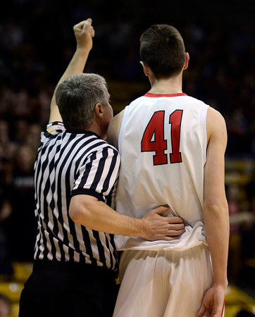 Fairview's Austin Sparks is patted on the back by the referee after being called for his second foul early in the first quarter against Boulder Saturday night Jan. 19, 2013 at the Coors Events Center. (Lewis Geyer/Times-Call)
